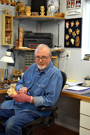 Dale Green carving in his new studio